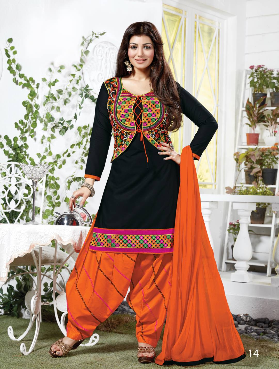 Fabulous Designer Black And Orange Cotton Patiala Suit