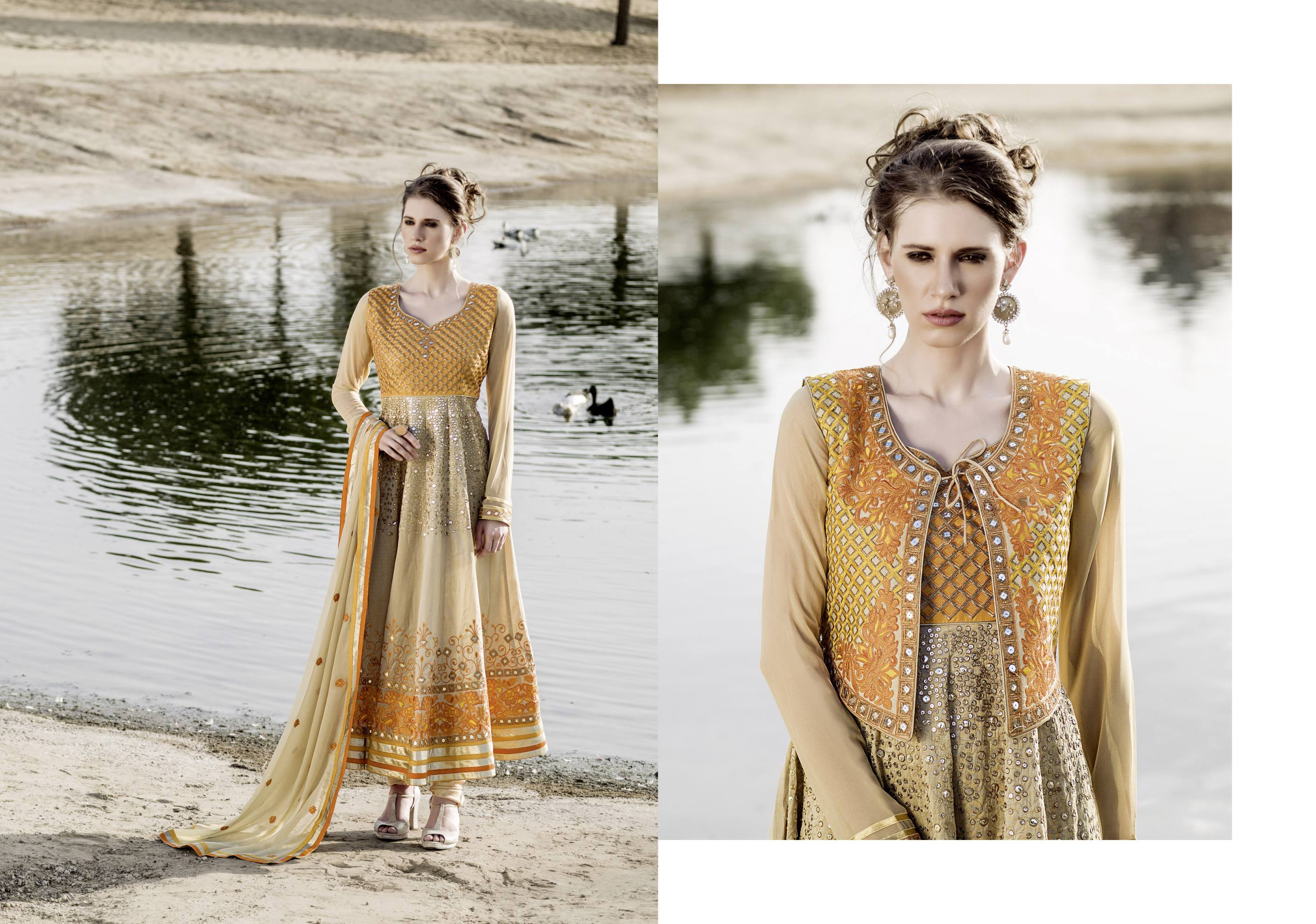 Beautiful Cream & Orange Heavy Neck Embroidered Anarkali Suit