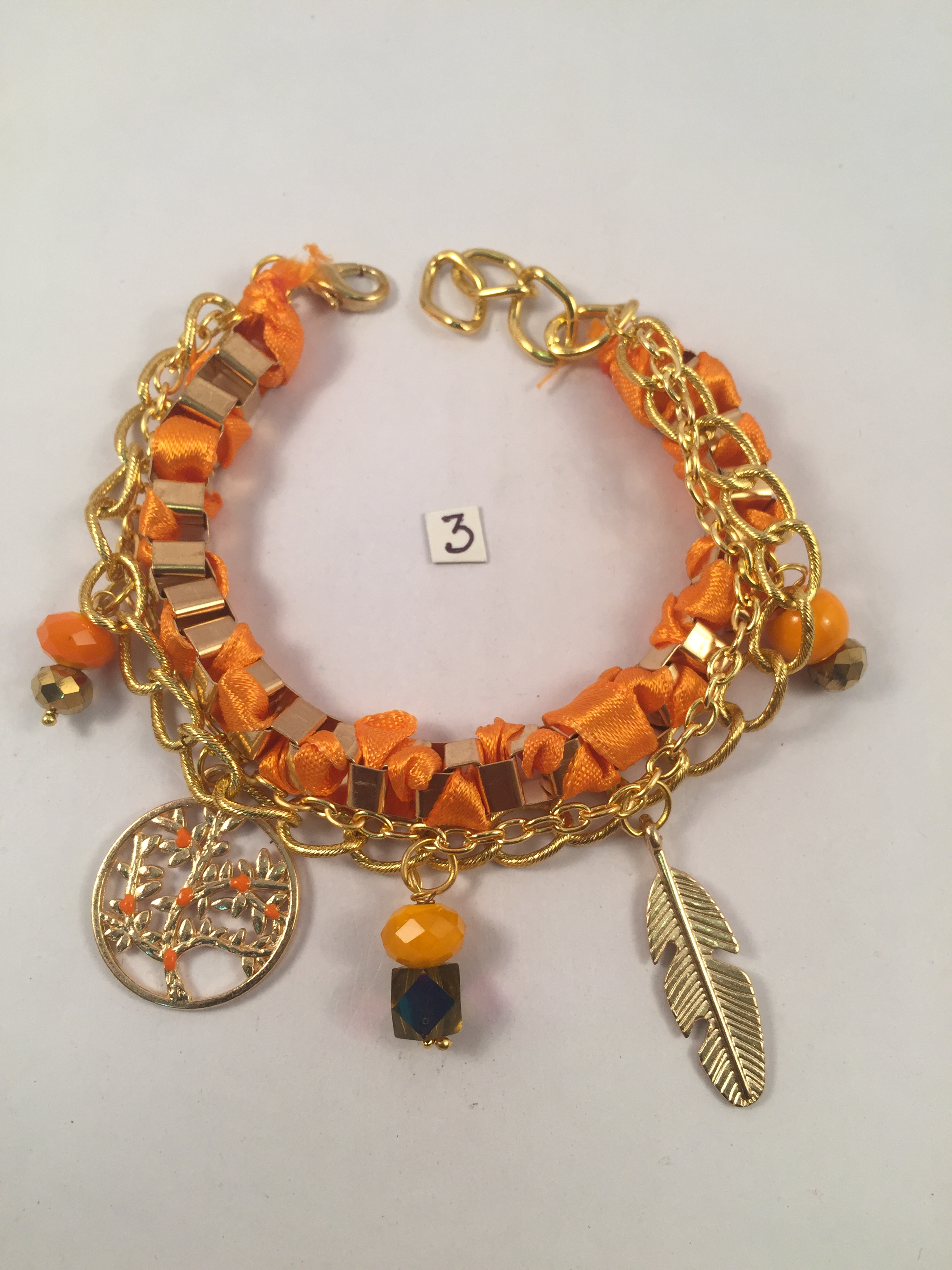 Bright orange multi chain charms bracelet