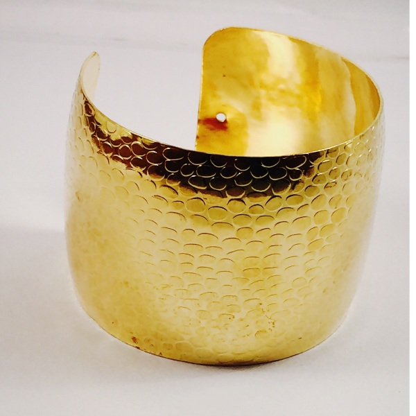 GOld toned cuff bracelet  self printed