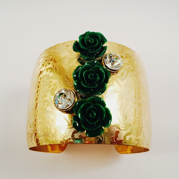Gold toned cuff bracelet with chic and beautiful green roses and stones