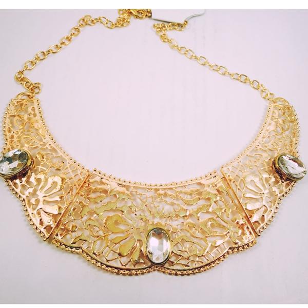 Gold toned beautifully designed with glamorous stoned necklace