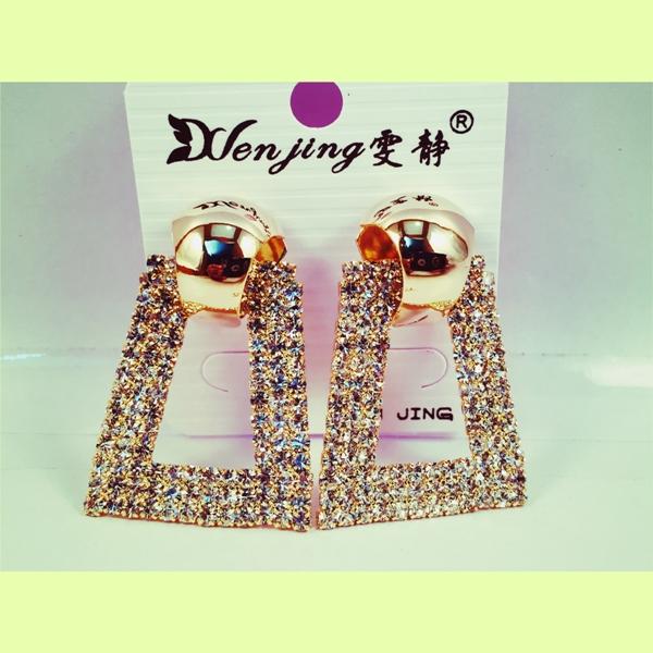 Diamondand gold toned earrings