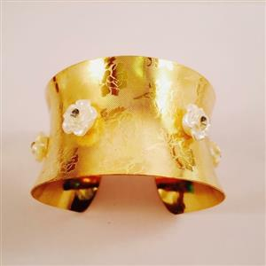 Gold toned cuff bracelet with pearl flowers