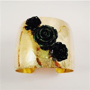 Gold toned cuff bracelet with chic and beautiful black roses