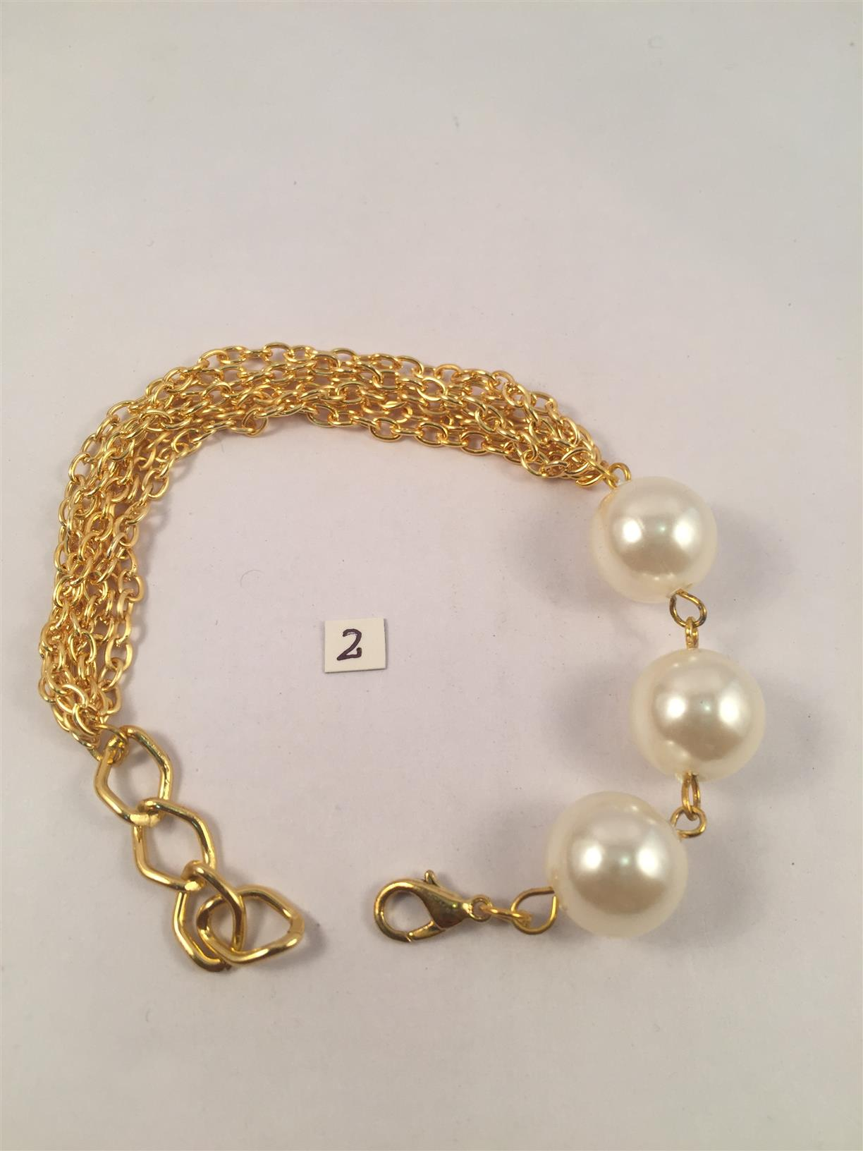 Chunky pearl gold toned chain bracelet