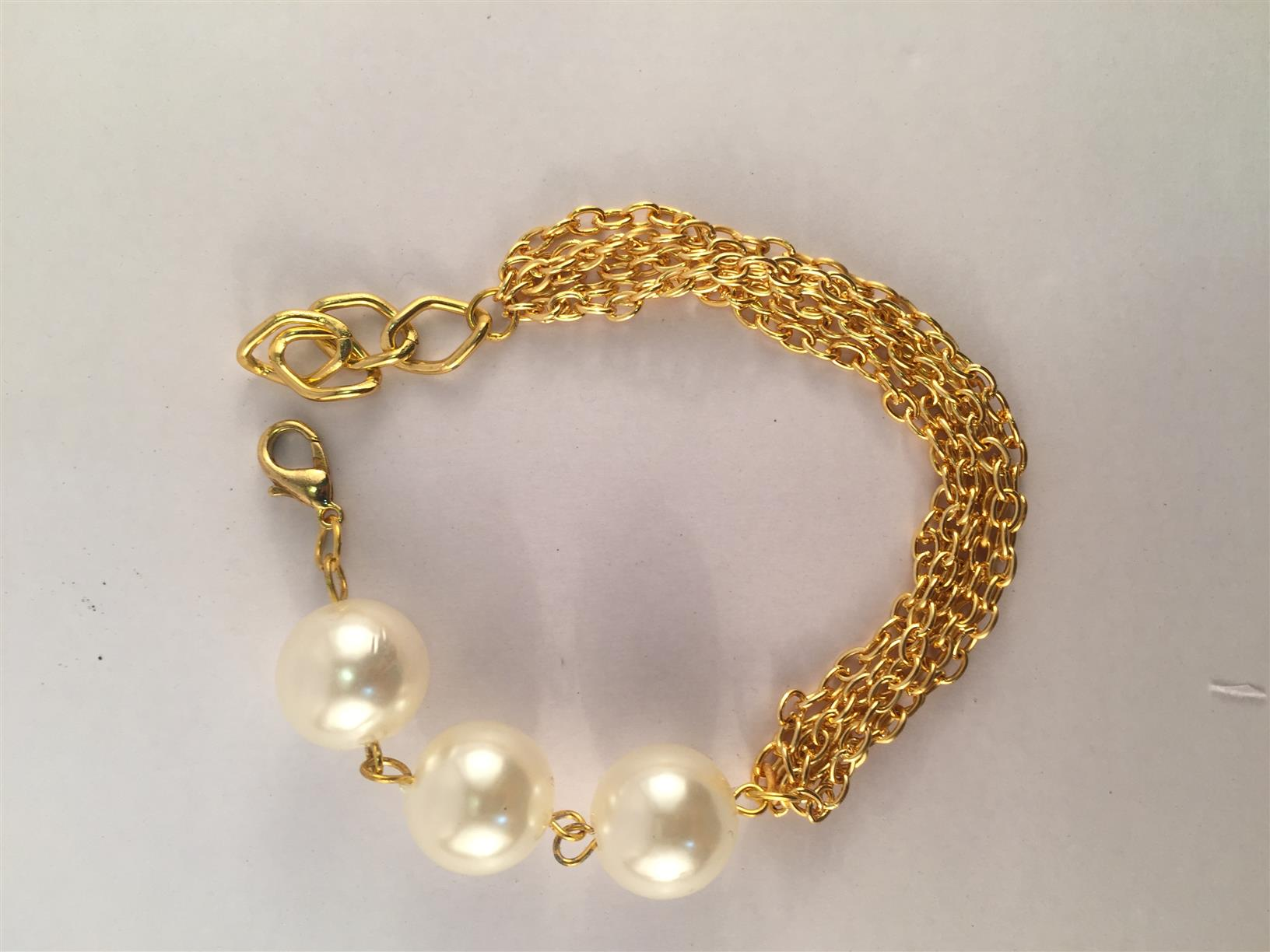 Multi chain bracelet with pearls