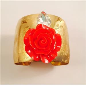 GOld toned cuff bracelet with big red flower and shiney stone