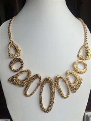 Gold toned multi shaped beautiful chic necklace