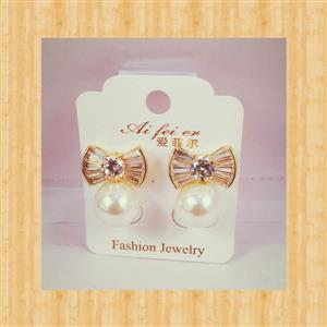 Crsytal bow and pearl earrings