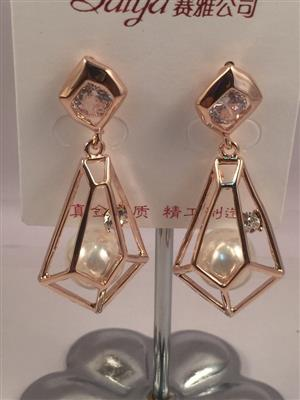 Pentagonal ball and crystal earrings
