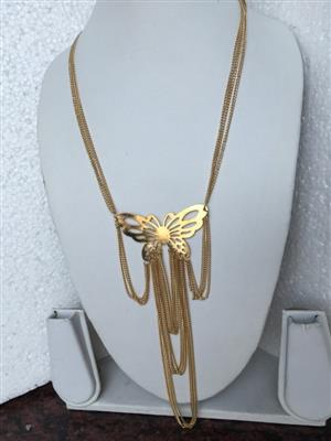 Gold toned butterfly multi chain necklace