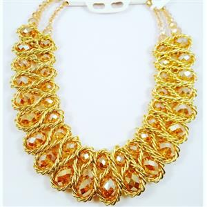 Glittering gold crystals entwined in a gold chain