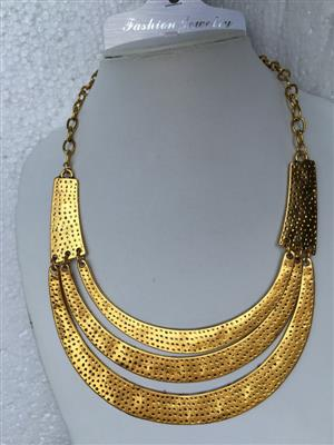 Bohemian Retro style set with golden toned Multi rounded necklace and stylish earrings